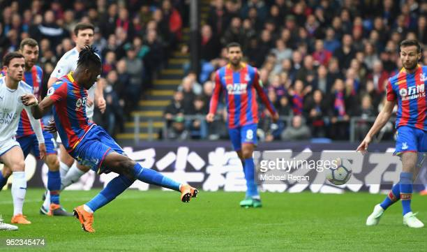 Wilfried Zaha of Crystal Palace scores his sides first goal during the Premier League match between Crystal Palace and Leicester City at Selhurst...