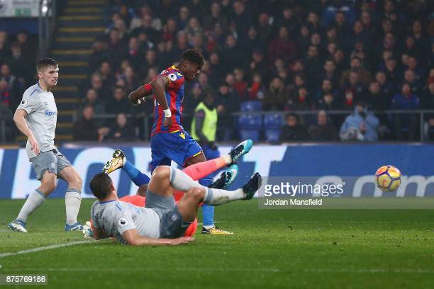 Wilfried Zaha of Crystal Palace scores his side's second goal to make it 21 during the Premier League match between Crystal Palace and Everton at...