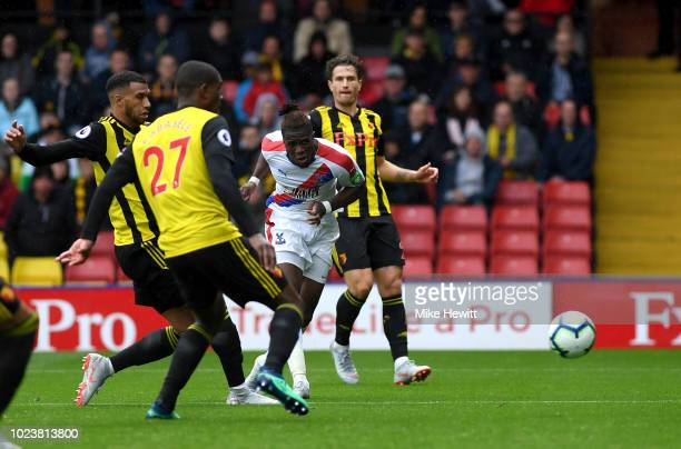 Wilfried Zaha of Crystal Palace scores his team's first goal during the Premier League match between Watford FC and Crystal Palace at Vicarage Road...