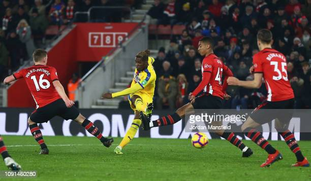 Wilfried Zaha of Crystal Palace scores his team's first goal during the Premier League match between Southampton FC and Crystal Palace at St Mary's...