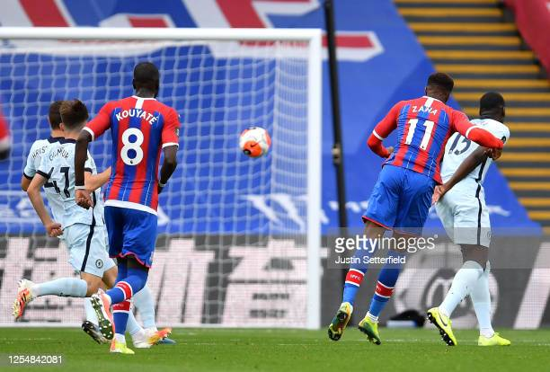 Wilfried Zaha of Crystal Palace scores his team's first goal during the Premier League match between Crystal Palace and Chelsea FC at Selhurst Park...
