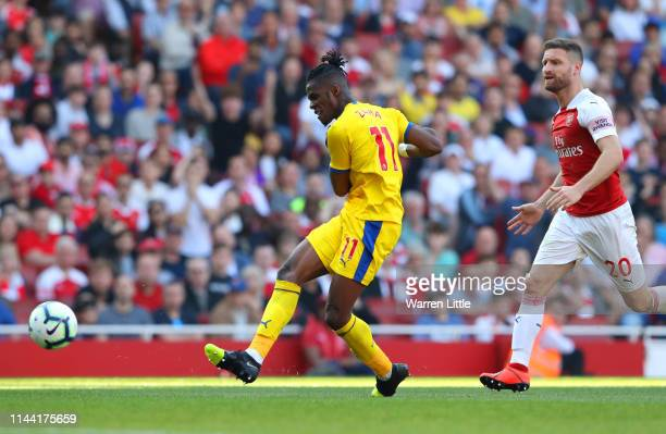 Wilfried Zaha of Crystal Palace scores his team's second goal during the Premier League match between Arsenal FC and Crystal Palace at Emirates...