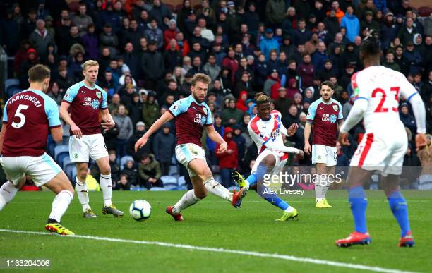Wilfried Zaha of Crystal Palace scores his team's third goal during the Premier League match between Burnley FC and Crystal Palace at Turf Moor on...