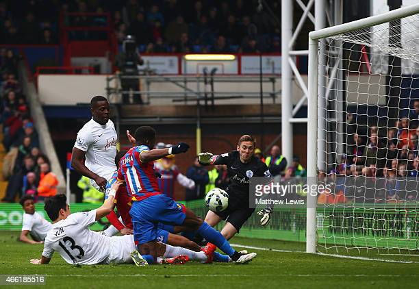 Wilfried Zaha of Crystal Palace scores the opening goal during the Barclays Premier League match between Crystal Palace and Queens Park Rangers at...