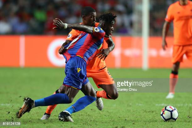 Wilfried Zaha of Crystal Palace shields the ball away from Georginio Wijnaldum of Liverpool during the Premier League Asia Trophy match between...