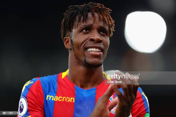 Wilfried Zaha of Crystal Palace shows appreciation to the fans after the Premier League match between Crystal Palace and Chelsea at Selhurst Park on...