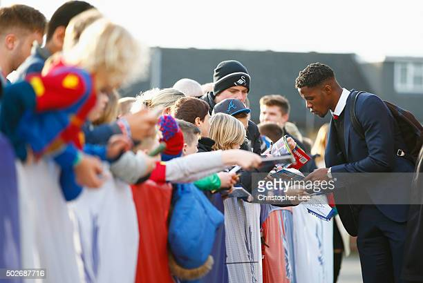Wilfried Zaha of Crystal Palace signs autographs for fans prior to the Barclays Premier League match between Crystal Palace and Swansea City at...