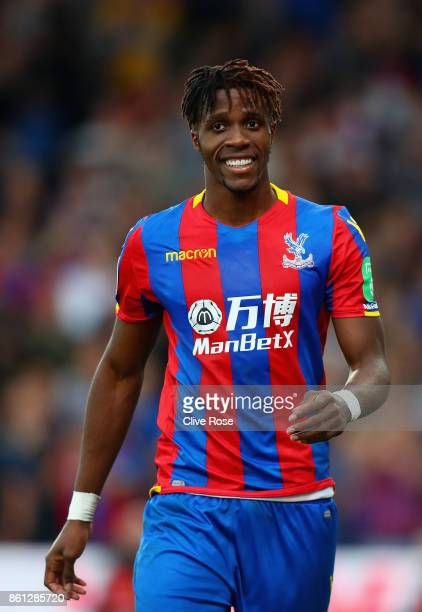 Wilfried Zaha of Crystal Palace smiles during the Premier League match between Crystal Palace and Chelsea at Selhurst Park on October 14 2017 in...
