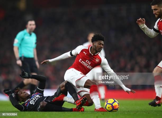 Wilfried Zaha of Crystal Palace tackles Ainsley MaitlandNiles of Arsenal during the Premier League match between Arsenal and Crystal Palace at...