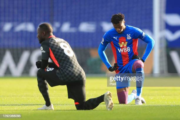 Wilfried Zaha of Crystal Palace takes a knee in support of the 'Black Lives Matter' movement during the Premier League match between Crystal Palace...
