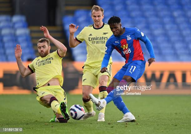 Wilfried Zaha of Crystal Palace takes a shot which is blocked by Calum Chambers of Arsenal during the Premier League match between Crystal Palace and...
