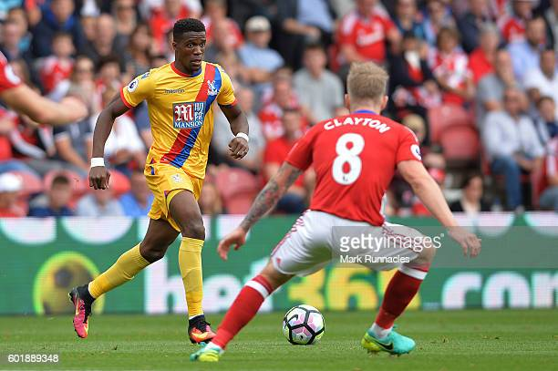 Wilfried Zaha of Crystal Palace takes on Adam Clayton of Middlesbrough during the Premier League match between Middlesbrough and Crystal Palace at...