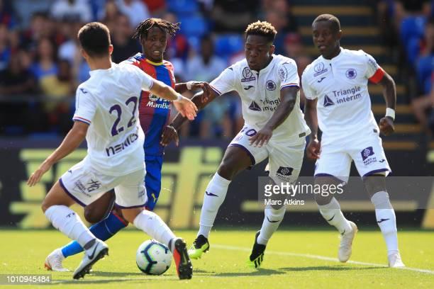 Wilfried Zaha of Crystal Palace takes on Manu Garcia Aaron Leya Iseka and MaxAlain Gradel of Toulouse during the PreSeason Friendly between Crystal...