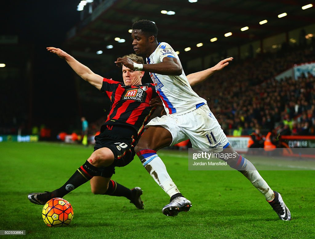 Wilfried Zaha of Crystal Palace takes on Matt Ritchie of Bournemouth during the Barclays Premier League match between A.F.C. Bournemouth and Crystal Palace at Vitality Stadium on December 26, 2015 in Bournemouth, England.