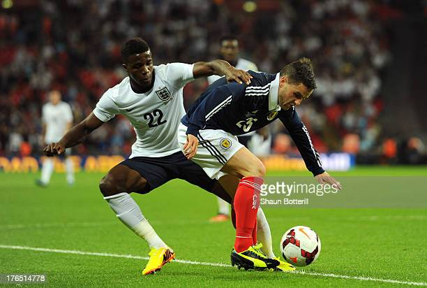 Wilfried Zaha of England in action against Craig Conway of Scotland during the International Friendly match between England and Scotland at Wembley...