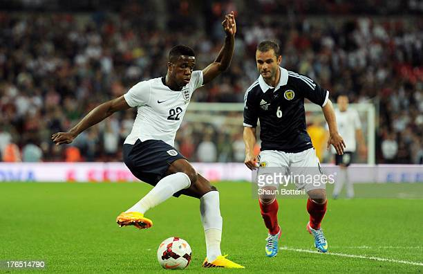 Wilfried Zaha of England in action against Shaun Maloney of Scotland during the International Friendly match between England and Scotland at Wembley...