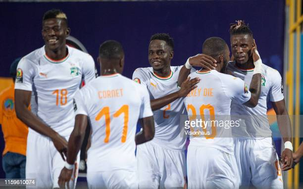 Wilfried Zaha of Ivory Coast celebrates his goal with Geoffroy Die Serey of Ivory Coast during the 2019 Africa Cup of Nations Group D match between...