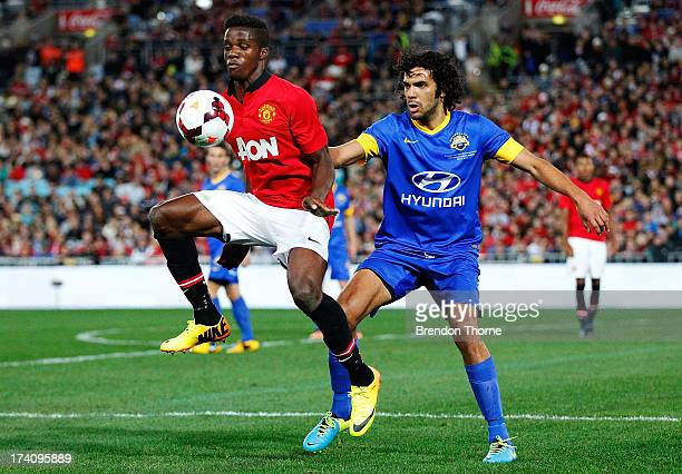 Wilfried Zaha of Manchester United competes with Nikolai ToporStanley of the AllStars during the match between the ALeague AllStars and Manchester...