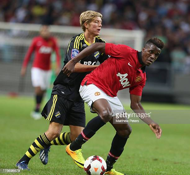 Wilfried Zaha of Manchester United in action with Anton Saletros of AIK Fotboll during the preseason friendly match between AIK Fotboll and...