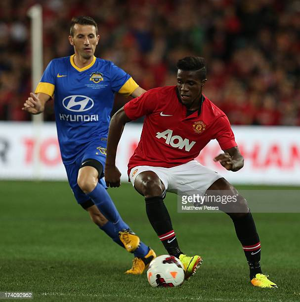 Wilfried Zaha of Manchester United in action with Liam Miller of ALeague AllStars during the match between the ALeague AllStars and Manchester United...