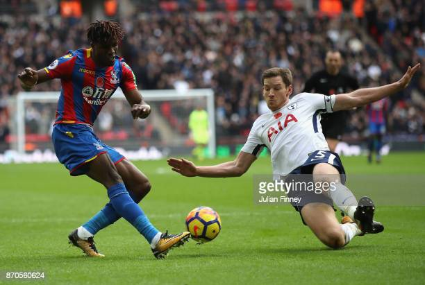 Wilfried Zaha of Palace crosses as Jan Vertonghen of Spurs tries to block during the Premier League match between Tottenham Hotspur and Crystal...