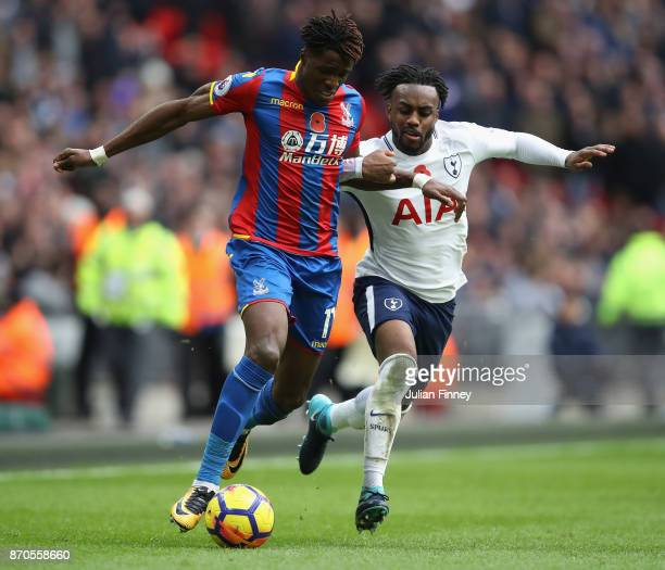Wilfried Zaha of Palace goes past Danny Rose of Spurs during the Premier League match between Tottenham Hotspur and Crystal Palace at Wembley Stadium...