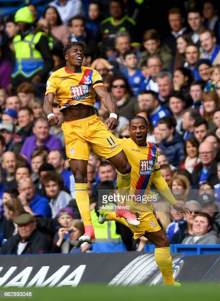Wilfried Zahaof Crystal Palace celebrates scoring his sides first goal with Jason Puncheon of Crystal Palace during the Premier League match between...