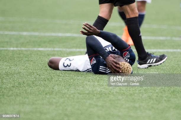 Wilfried Zahibo of New England Revolution holds his head after a clash of heads with Yangel Herrera of New York City during the New England...