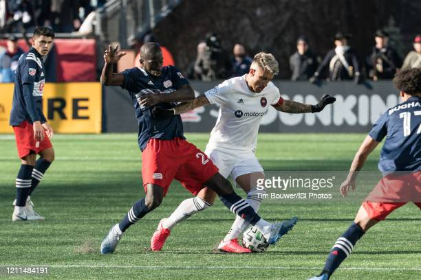Wilfried Zahibo of New England Revolution tackles Francisco Calvo of Chicago Fire during a game between Chicago Fire and New England Revolution at...