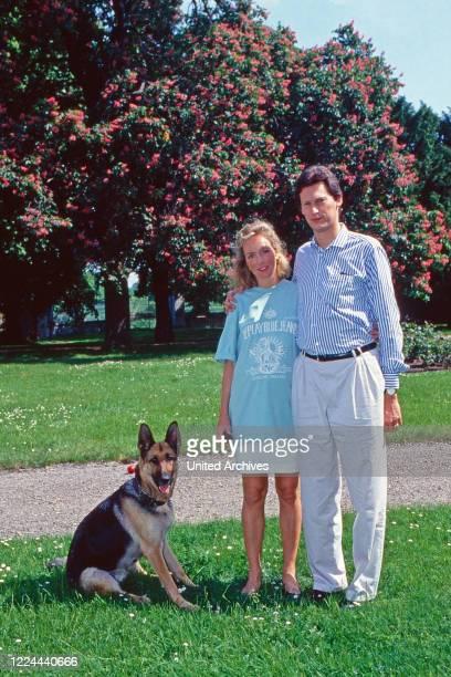 Wilhelm Albert Prince von Urach, Count of Wurttemberg, with his wife Karen, nee von Brauchitsch, with German Shepherd dog at Lichtenstein castle,...