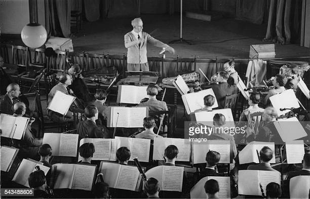 Wilhelm Furtwaengler is conducting the Berlin Philhamonic during a rehearsal Titania Palast Berlin 24 May 1947 Photograph