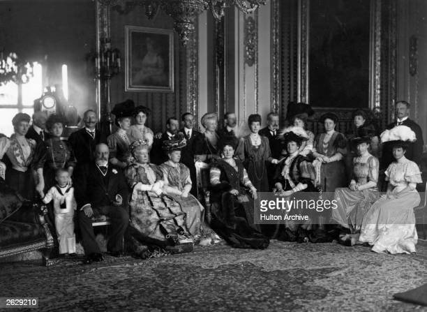 Wilhelm II 3rd Emperor of Germany 9th King of Prussia stands behind King Edward VII in a large Royal family group gathered to be photographed