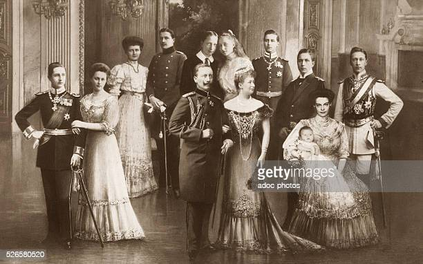 Wilhelm II German Emperor and his spouse Augusta Victoria of SchleswigHolstein German Empress with their children escorted by their spouses Ca 1915...