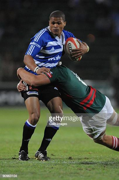 Wilhelm Koch tackles Juan de Jongh during the Absa Currie Cup match between Platinum Leopards and Western Province from Coca-Cola Park on September...