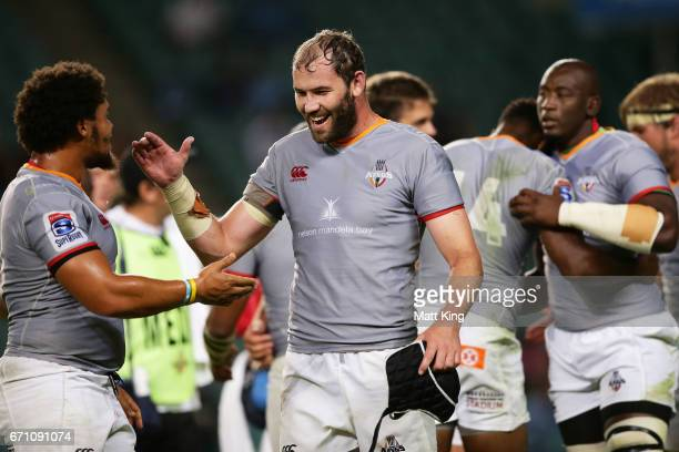 Wilhelm van der Sluys of the Kings celebrates victory with Dayan van der Westhuizen of the Kings during the round nine Super Rugby match between the...