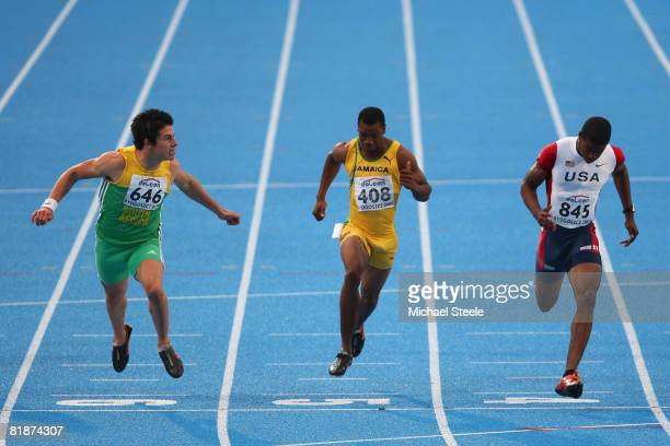 Wilhelm Van Der Vyver of South Africa finishes in second place in the men's 100m final from fourth place Yohan Blake of Jamaica and bronze medallist...