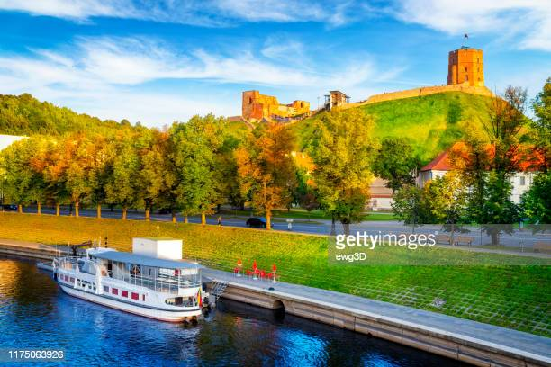 wilia river and gediminas tower on the hill, vilnius, lithuania - lithuania stock pictures, royalty-free photos & images