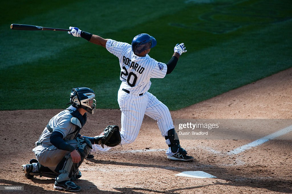 Wilin Rosario hits a three-run home run in the seventh inning against the San Diego Padres at Coors Field on April 7, 2013 in Denver, Colorado. The Rockies beat the Padres 9-1.