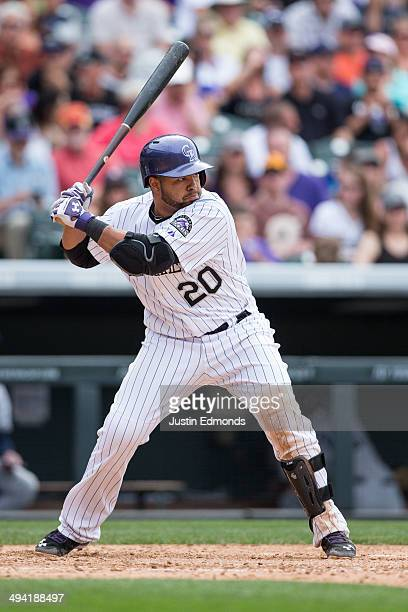 Wilin Rosario of the Colorado Rockies bats against the San Diego Padres at Coors Field on May 18 2014 in Denver Colorado The Rockies defeated the...