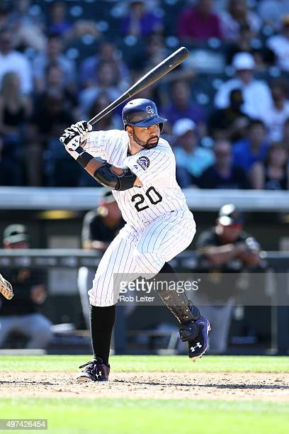 Wilin Rosario of the Colorado Rockies bats during the game against the Pittsburgh Pirates at Coors Field on September 24 2015 in Denver Colorado The...
