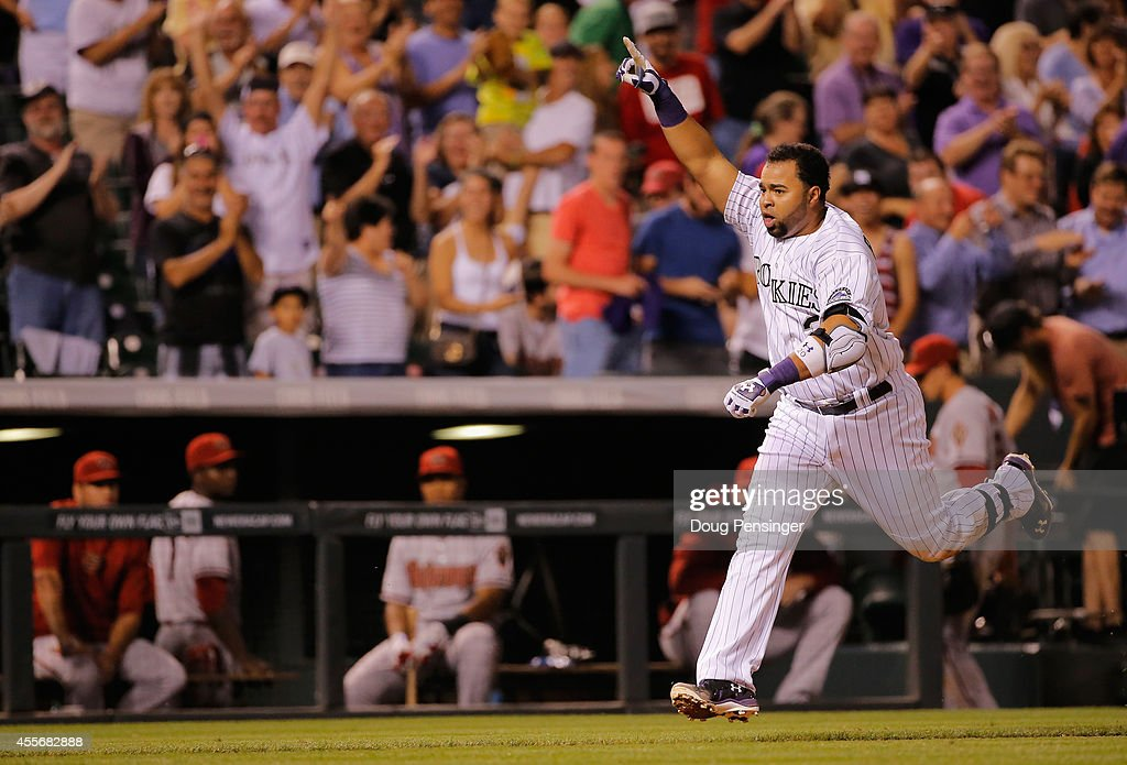 Wilin Rosario #20 of the Colorado Rockies celebrates as he comes home to score on his game winning walk off two run home run off of Addison Reed #43 of the Arizona Diamondbacks at Coors Field on September 18, 2014 in Denver, Colorado. The Rockies defeated the Diamondbacks 7-6.