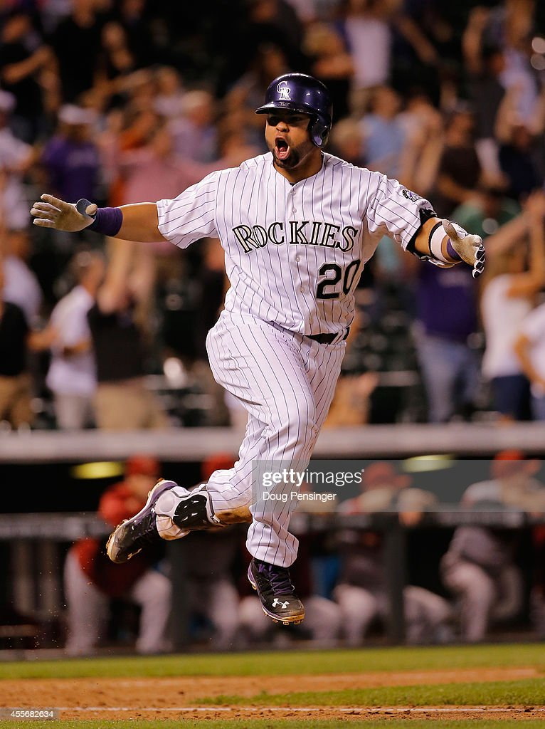 Wilin Rosario #20 of the Colorado Rockies celebrates as he hit the game winning walk off two run home run off of Addison Reed #43 of the Arizona Diamondbacks at Coors Field on September 18, 2014 in Denver, Colorado. The Rockies defeated the Diamondbacks 7-6.
