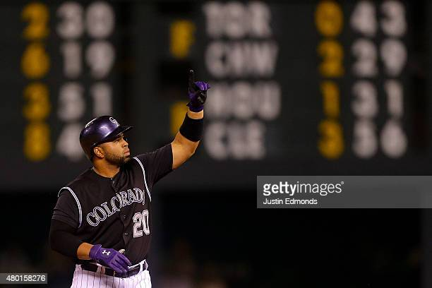 Wilin Rosario of the Colorado Rockies celebrates his RBI double during the first inning against the Atlanta Braves at Coors Field on July 9 2015 in...