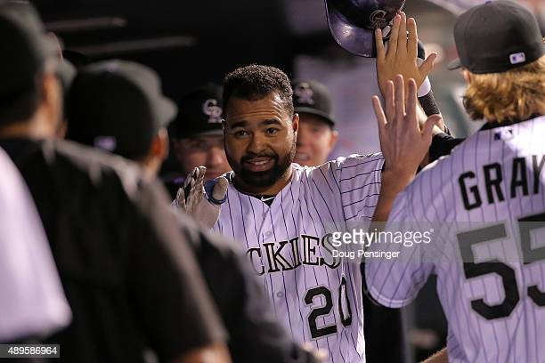 Wilin Rosario of the Colorado Rockies celebrates his solo home run off of starting pitcher JA Happ of the Pittsburgh Pirates as the Pirates held a 31...