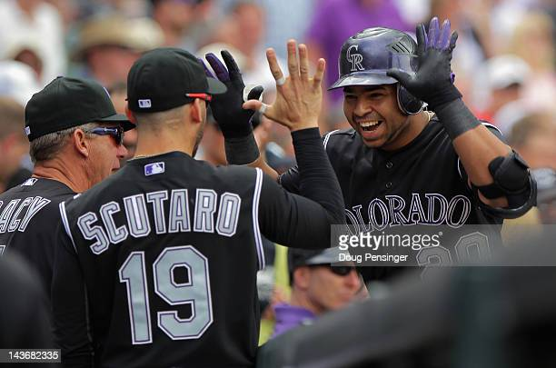 Wilin Rosario of the Colorado Rockies celebrates his solo homerun off of starting pitcher Clayton Kershaw of the Los Angeles Dodgers with Marco...