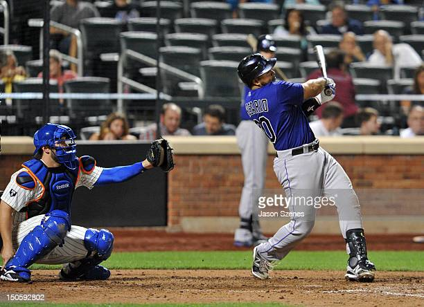 Wilin Rosario of the Colorado Rockies connects on a solo home run in the seventh inning during game action against the New York Mets at Citi field...