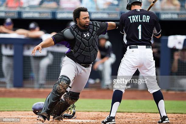 Wilin Rosario of the Colorado Rockies defends his position during a spring training game against the Seattle Mariners at the Peoria Sports Complex on...
