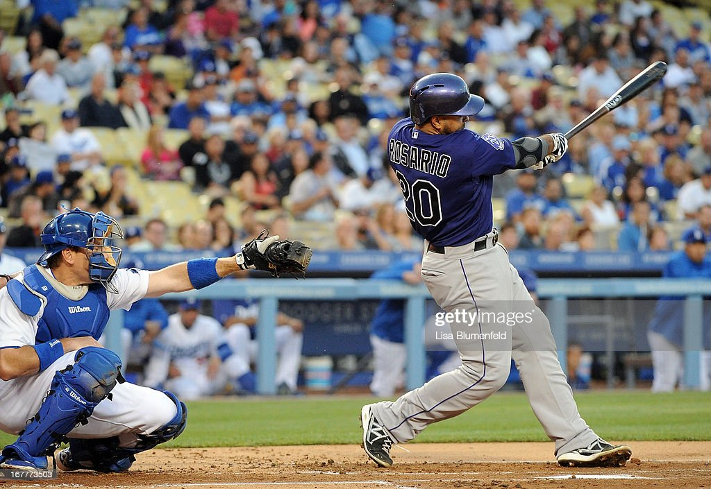 Wilin Rosario #20 of the Colorado Rockies hits a three run homerun in the first inning against the Los Angeles Dodgers at Dodger Stadium on April 29, 2013 in Los Angeles, California.