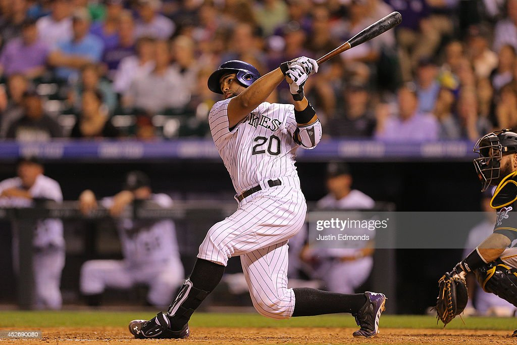 Wilin Rosario #20 of the Colorado Rockies hits an RBI double during the seventh inning against the Pittsburgh Pirates at Coors Field on July 25, 2014 in Denver, Colorado.