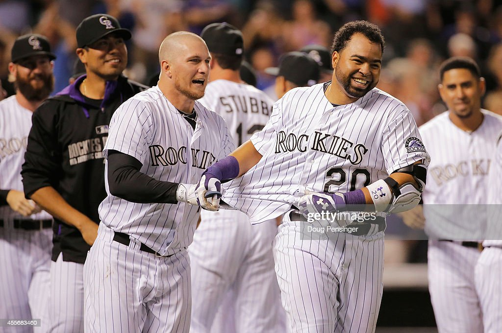 Wilin Rosario #20 of the Colorado Rockies is congratulated by Brandon Barnes #1 of the Colorado Rockies after hitting the game winning walk off two run home run off of Addison Reed #43 of the Arizona Diamondbacks at Coors Field on September 18, 2014 in Denver, Colorado. The Rockies defeated the Diamondbacks 7-6.
